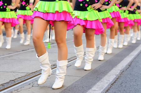specific clothing: Pretty drum majorettes on the carnival, detail
