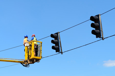 updated: Workers the updated traffic lights on the latest LED