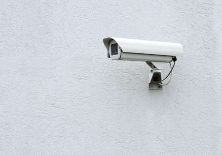 cctv security: CCTV security camera on a gray the wall