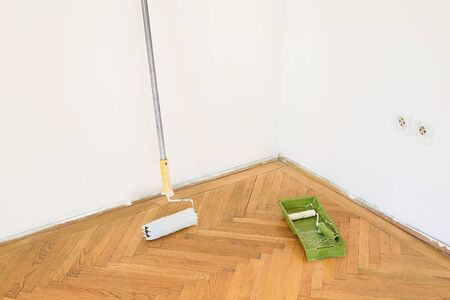 home decorating: Used home decorating tools on the floor Stock Photo