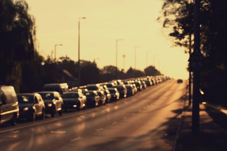 out of focus: Blurred photo of traffic jam at early morning