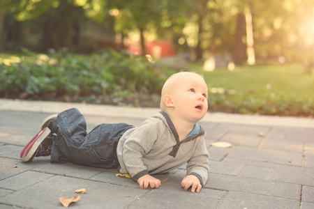hand free: Adorable baby in the park on a sunny day