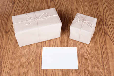 no: Gift packages wrapped in brown recycled paper on wooden background
