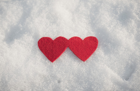 winters: Red heart shapes on snow a winters day