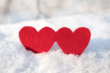 s shape: Red heart shapes on snow a winters day