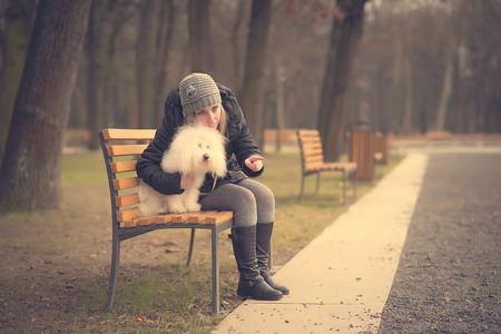 bichon bolognese: Dog with owner in the park, vintage photo