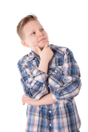 beautiful little boys: Handsome boy cogitate over the white background Stock Photo