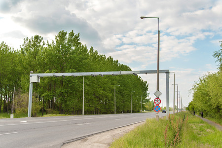 summons: Static speed camera system on a rural road