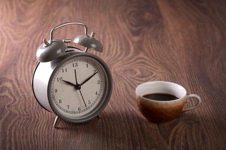 mocca: Coffee  and antique clock on wooden background