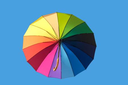 rainbow umbrella: Rainbow umbrella isolated on blue sky