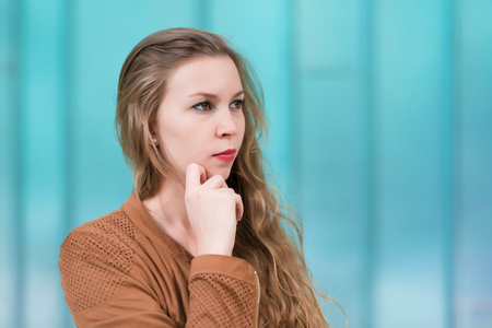 Closeup photo of a beauty woman over the blue background Stock Photo