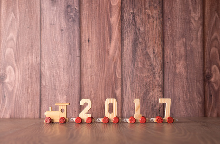 New year 2017 train on a wooden background