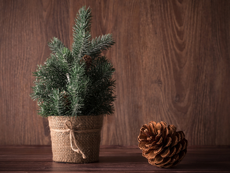 plastic christmas tree: Christmas concept on a wooden background