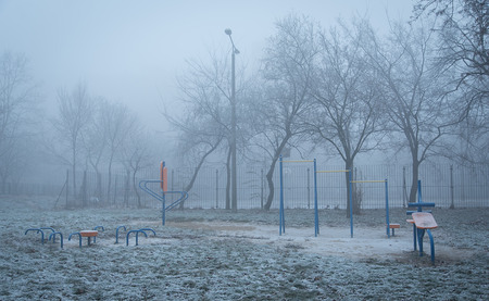 winters: Public park and fitness equipment a foggy winters day Stock Photo