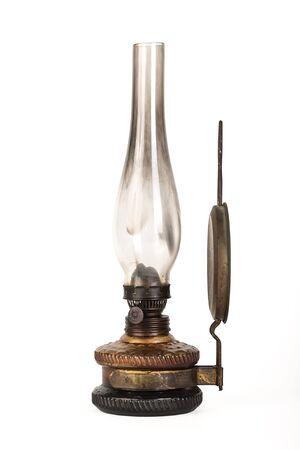 Old kerosene lamp isolated on white background