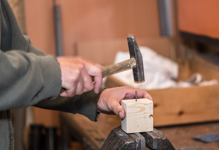 vise: Wooden workpiece on the vise. Man working with wooden.