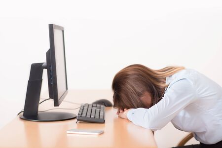 Tired young woman resting in the office Stock Photo