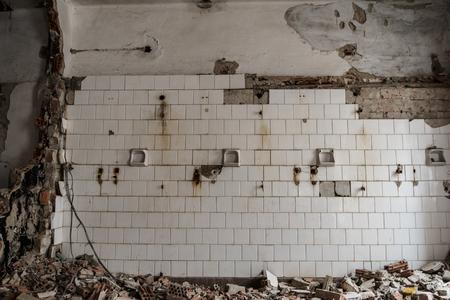 Abandoned building interior. Photo of broken bathroom