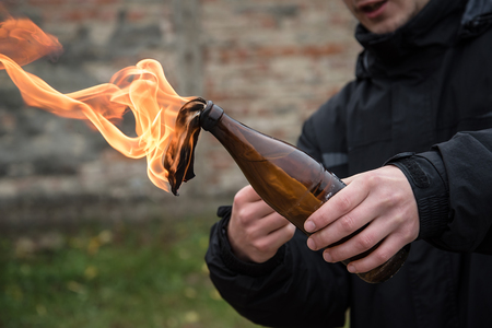 Man attack with molotov cocktail in public area