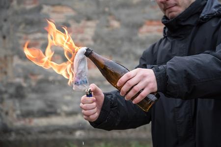 Man attack with molotov cocktail in public area Stock Photo