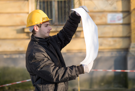 Young worker man looking a plan in construction Stock Photo