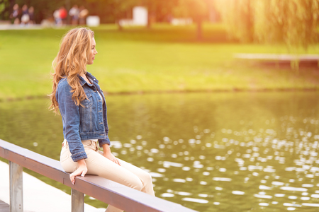 Beauty woman sitting in the green park Stock Photo