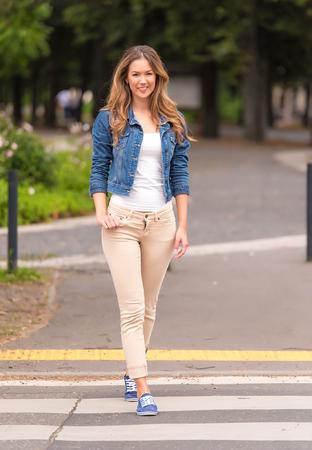 Beauty woman crossing the road. Pedestrian crossing