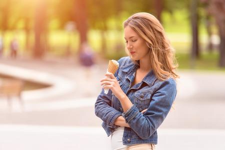 Beauty girl eating ice cream in summer