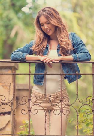 Soft photo of a beauty woman on fence