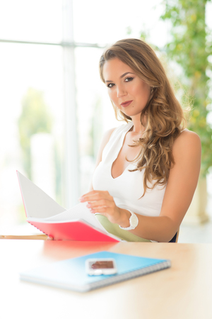 Beauty business woman read her note in the office