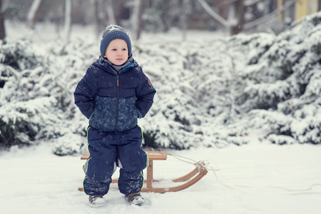Young boy in the winter park - Image