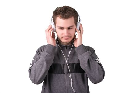 Handsome man listening music on a white background Stock Photo