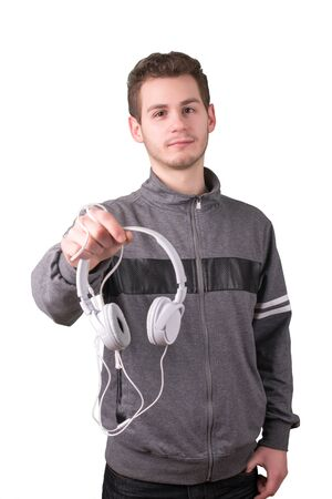 Handsome man holding a headphones on a white background