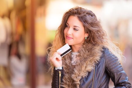 Beautiful woman in the street before shoping