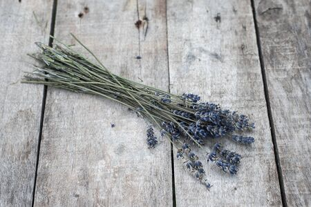 Lavender flower on a wooden table in the garden