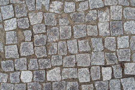 Antiguo camino pavimentado con piedras de granito para el fondo Foto de archivo