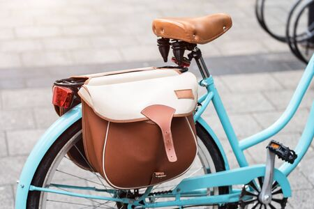 Brown leather bag on the bicycle. Stock Photo
