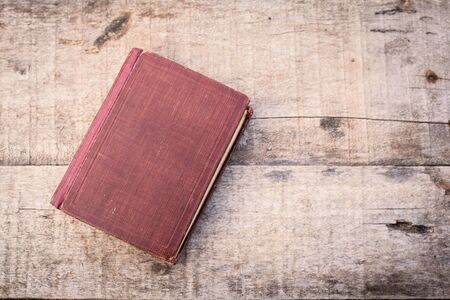 Old book on a wooden background