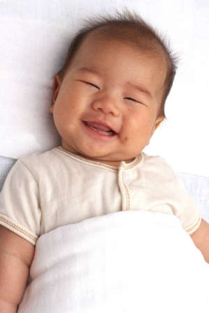 Asian baby smiling Stock Photo