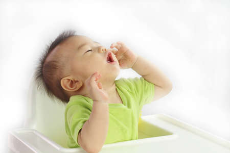 Asian baby calling Stock Photo