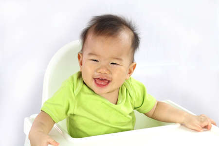 Asian baby laughing