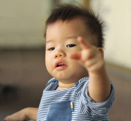 Asian child pointing Stock Photo