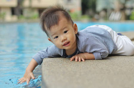 Asian child by the pool