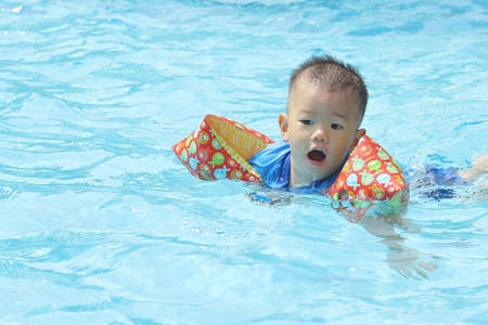 Oriental baby in pool photo