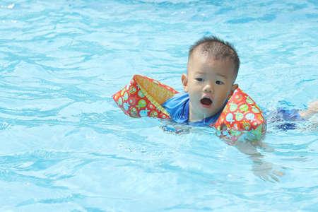 Oriental baby in pool