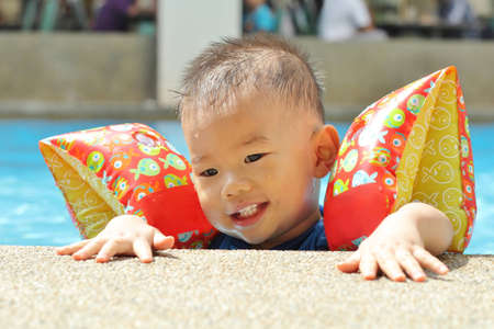 Asian baby in pool photo