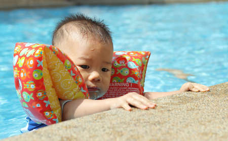 Asian baby in swimming pool Stock Photo