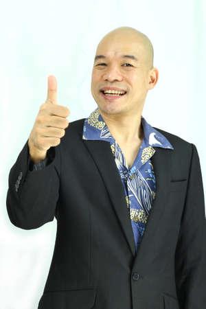 Asian man thumbs up