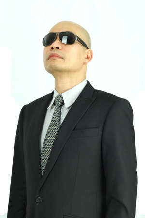 Asian man in suit and shades