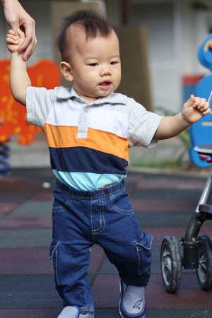 Asian baby walking